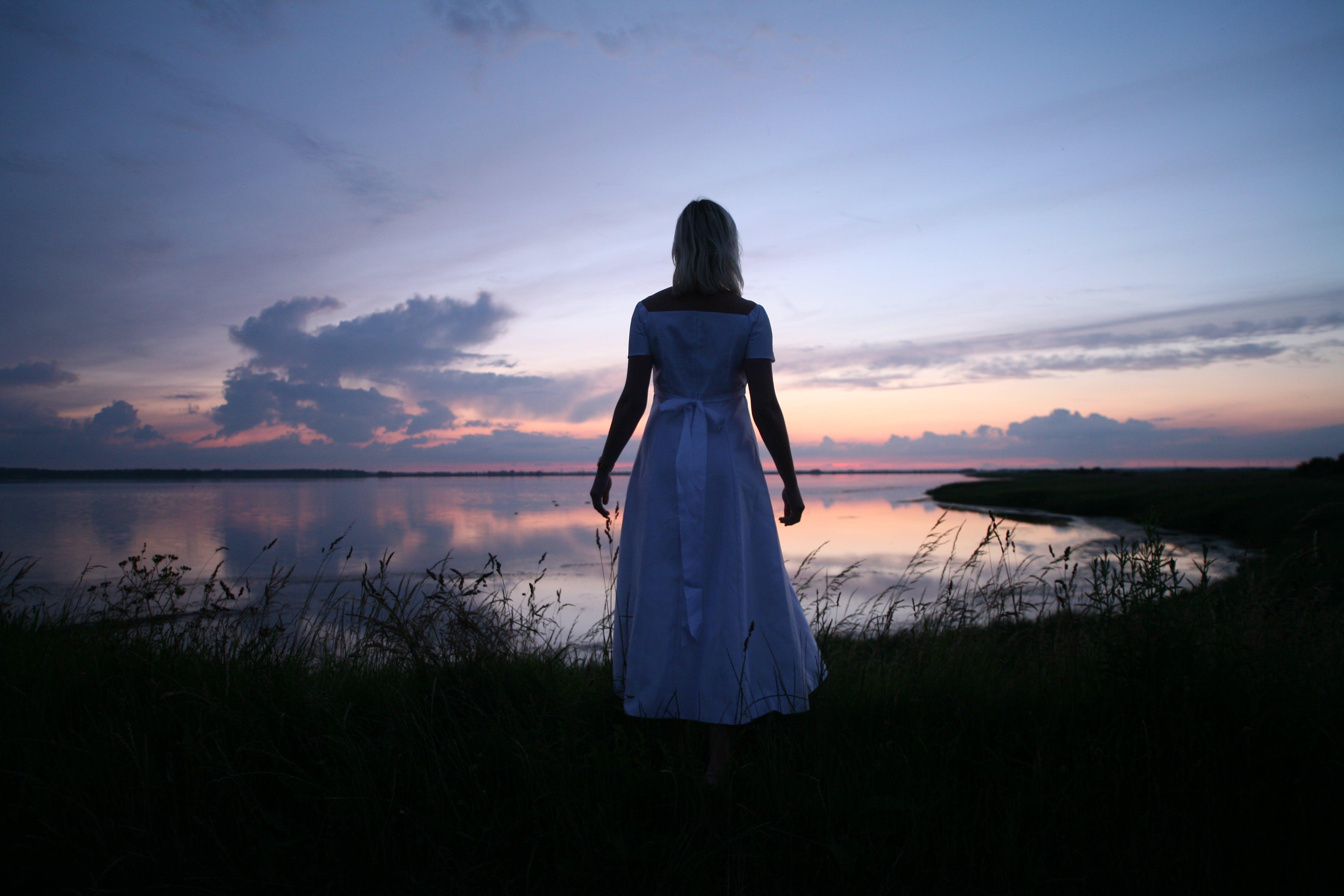 Women's in White Dress Near Body of Water