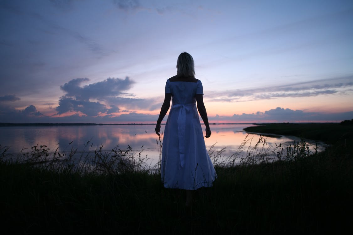 Women's in White Dress Near Body of Water