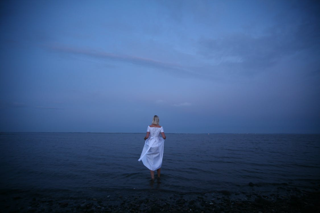 Woman Standing on Shoreline