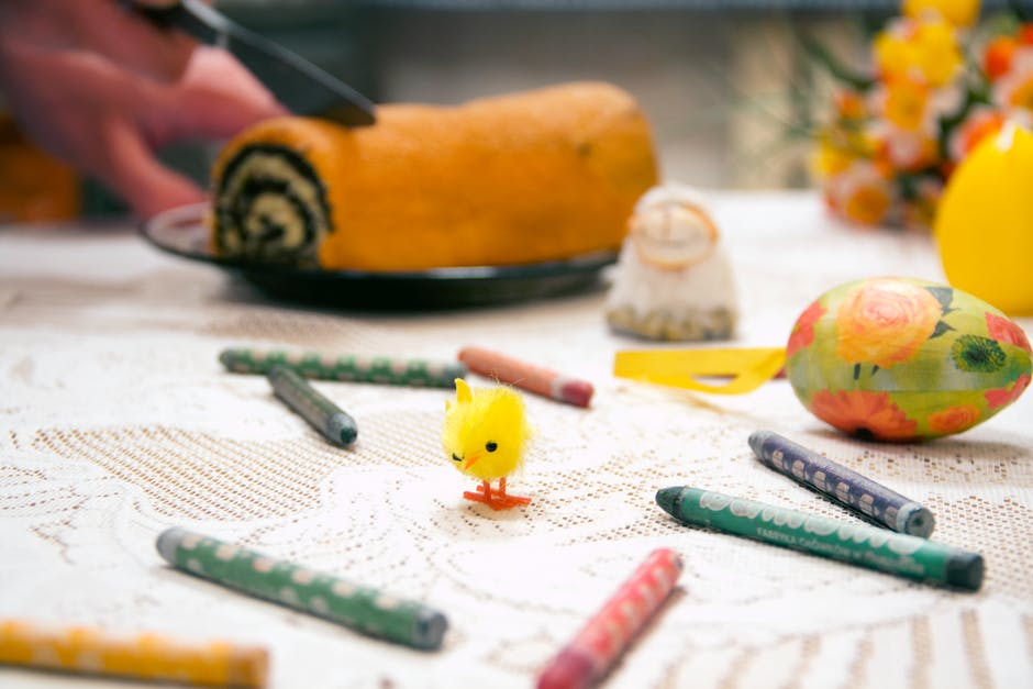 Yellow Chick Toy Surrounded by Assorted-color Crayons on Table Top