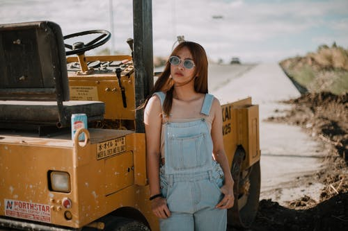 Photo Of Woman Leaning On Road Roller