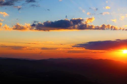 Ingyenes stockfotó naplemente, napnyugtakor ég témában