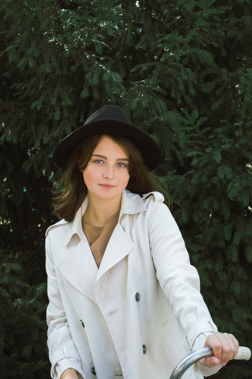Photo of Woman Wearing White Trench Coat