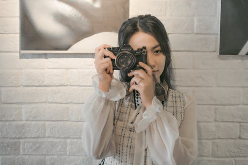 Photo of Woman Taking Photo Using Camera