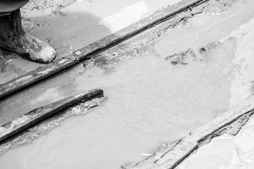 Free stock photo of boots, mud, rails, water