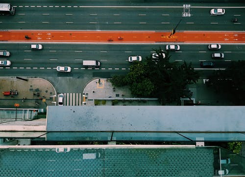 Top View Photo of Vehicles Driving on Road