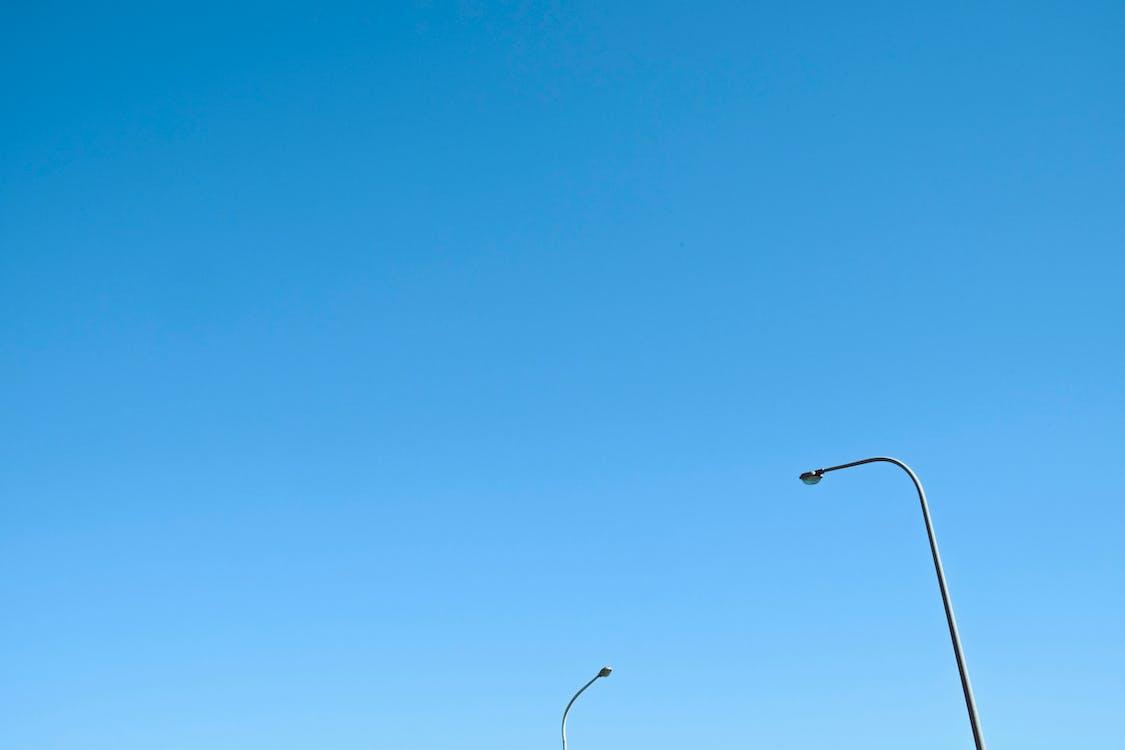 Photo of Street Lights Against Blue Sky