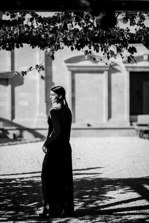 Woman Near Tree Grayscale Photo