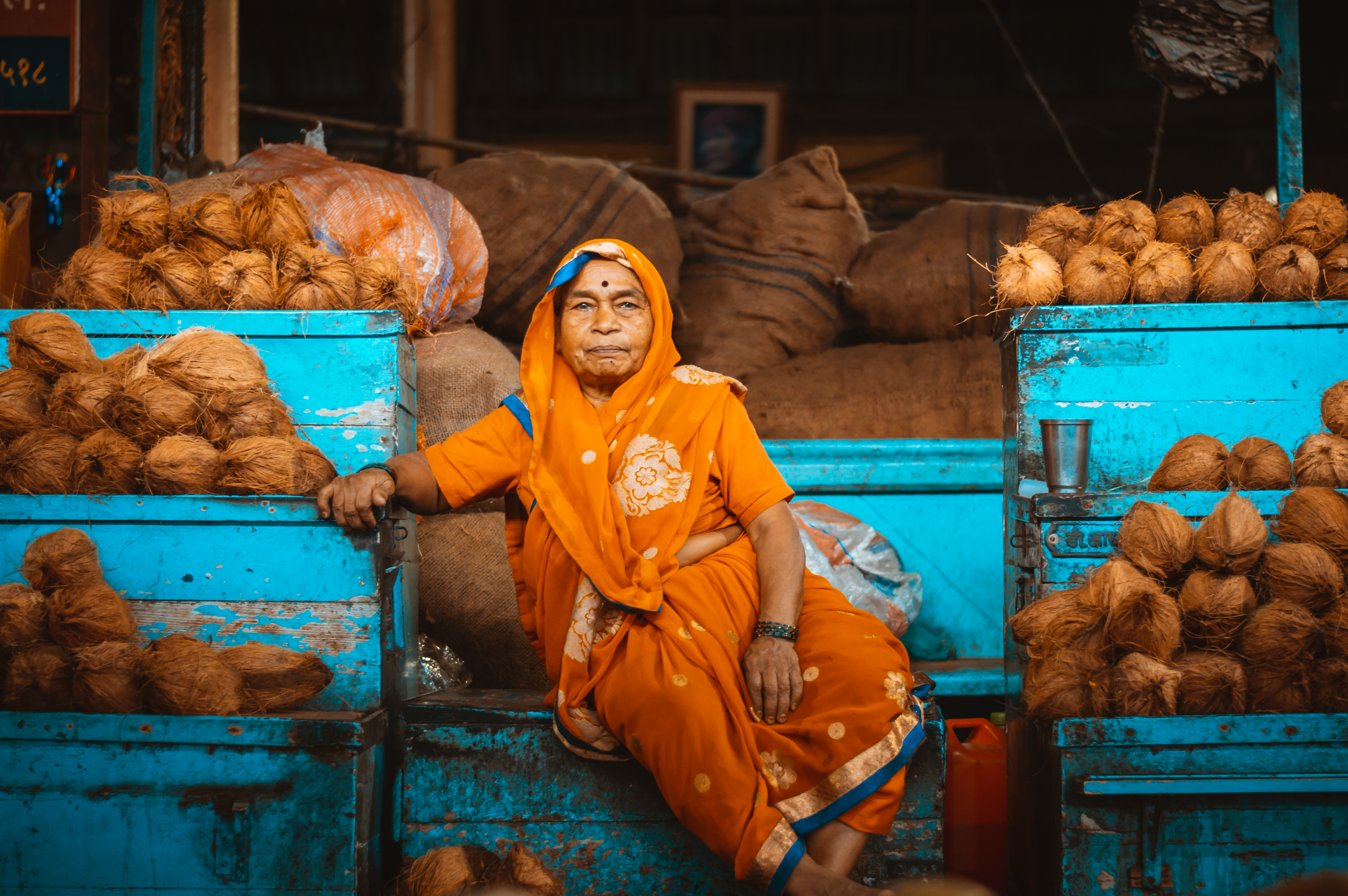 Woman Sitting on Containers