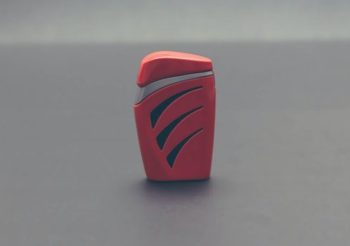 Close-up of Red Object over White Background