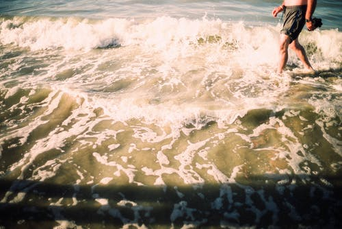 Person Walking in Seashore