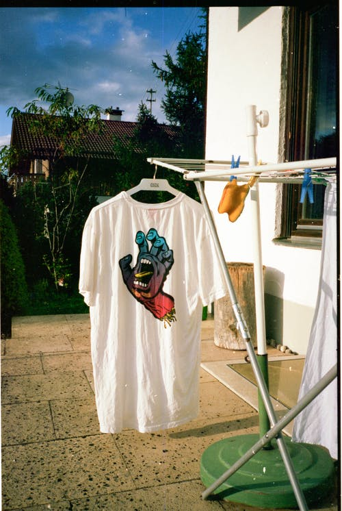 White T-shirt on Clothes Rack