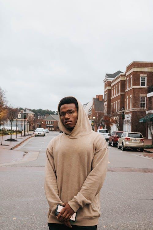 Photo Of Man Wearing Brown Hoodie