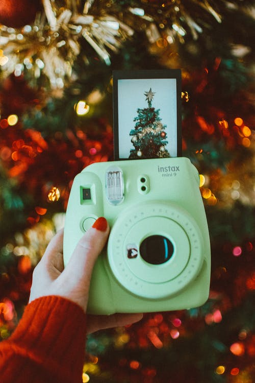 Photo of Person Holding an Instant Camera