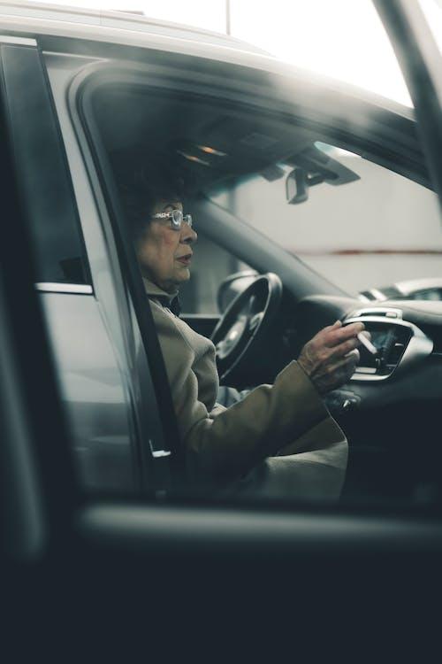 Woman Sitting While Smoking Inside Vehicle
