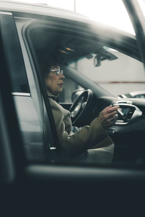 Woman Sitting While Smoking Inside Vehicle