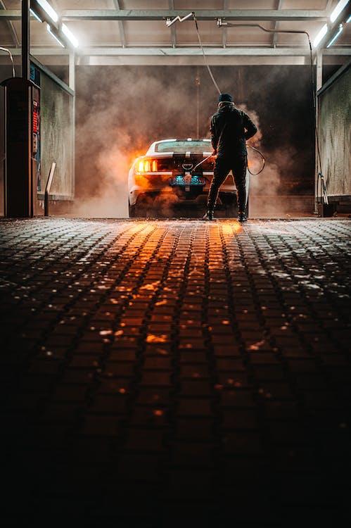 Car Being Wash by Man