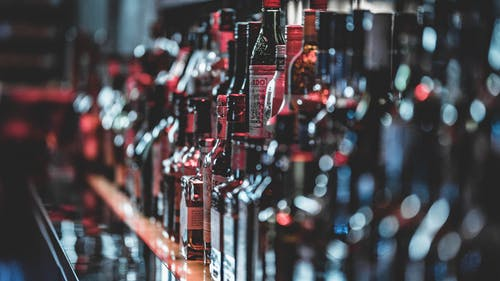 Selective Focus Photo Of Alcohol Bottles