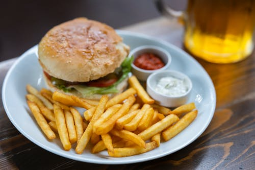 Burger and Potato Fries on Plate