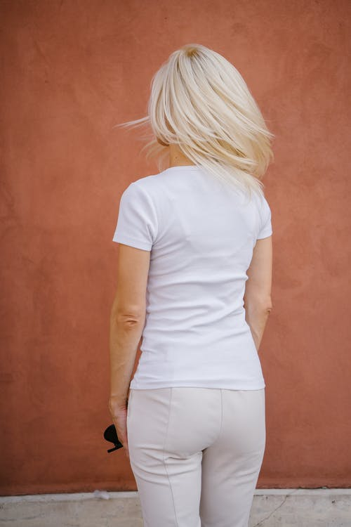 Woman in White T-shirt and White Pants