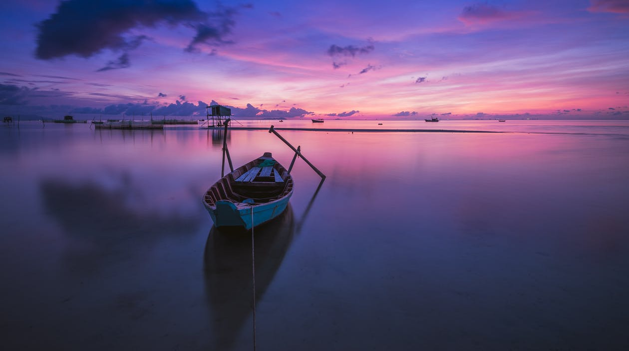 Green Boat With Oars on Both Side during Golden Hour Panoramic Photography
