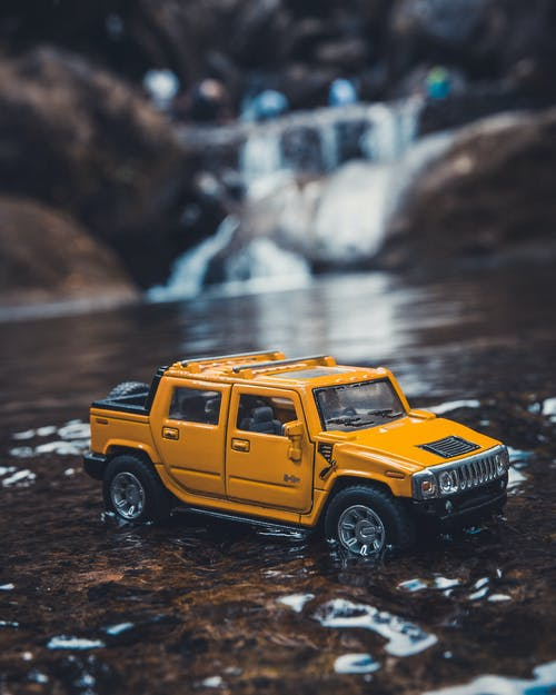 Yellow Hummer Suv Scale Model on River