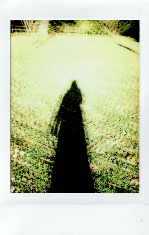 Long Shadow of a Person on the Grass