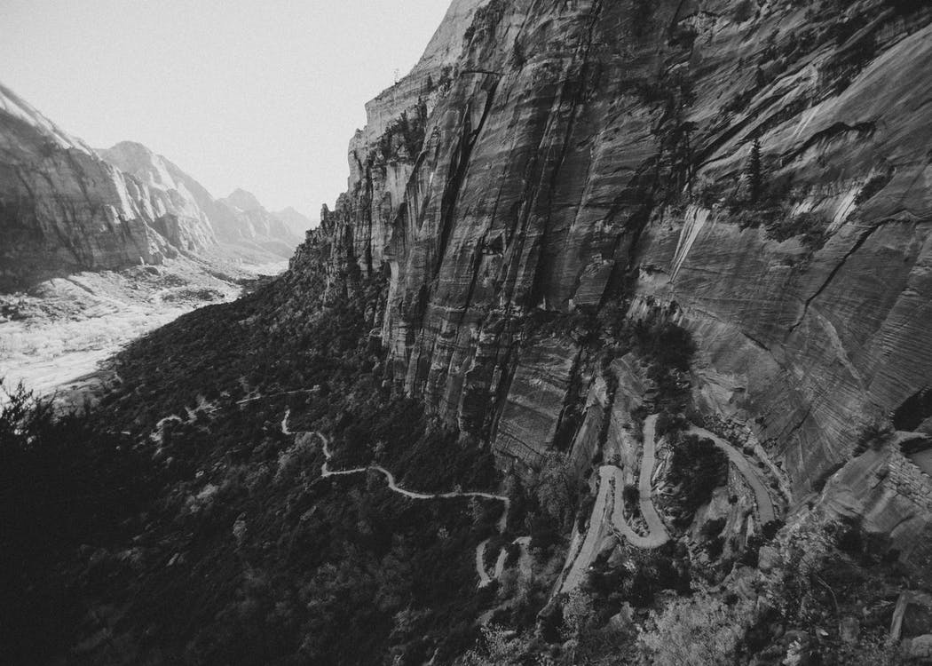 Grayscale Photo of Cliff