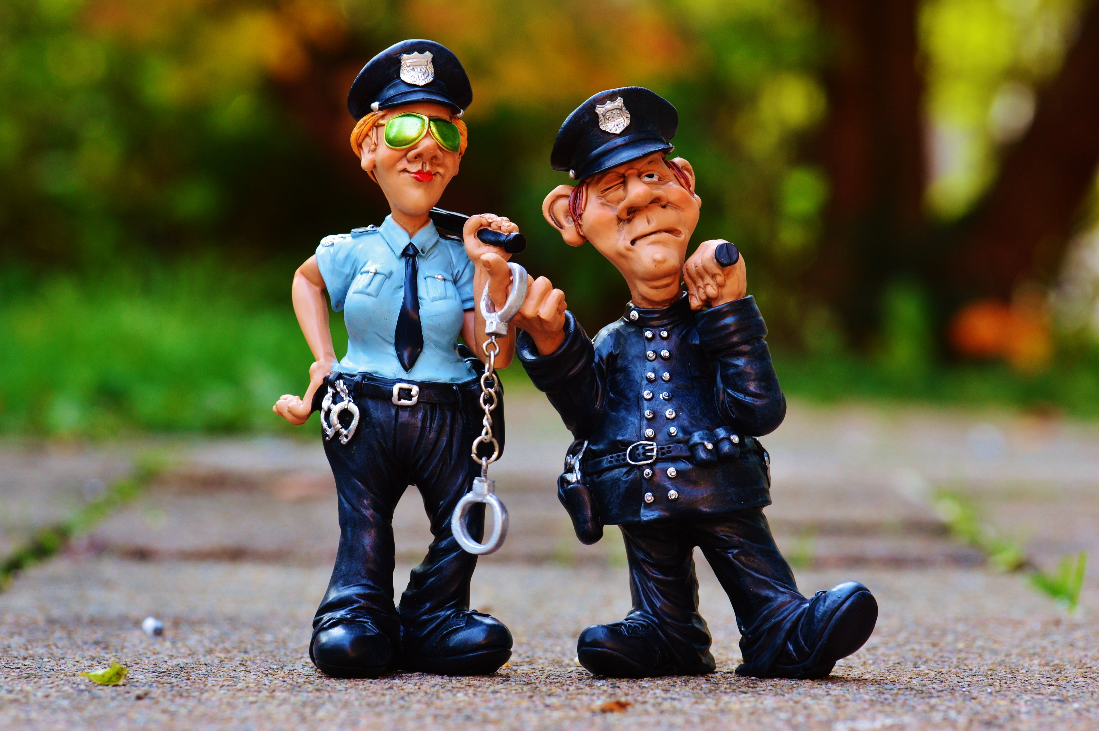 Police Man and Police Woman Plastic Toy on Fllow