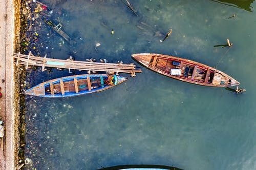 Two Blue and Brown Canoes