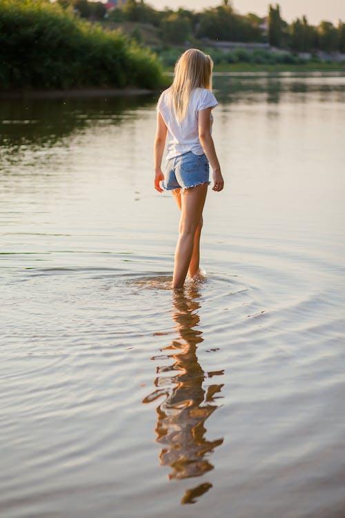 Woman Walking on Body of Water