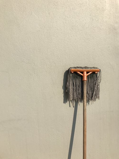 Gray and Brown Floor Mop on White Wall
