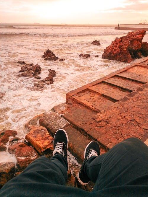 Man Overlooking the Sea during Golden Hour