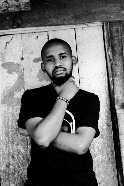 Free stock photo of black and white, man holding neck