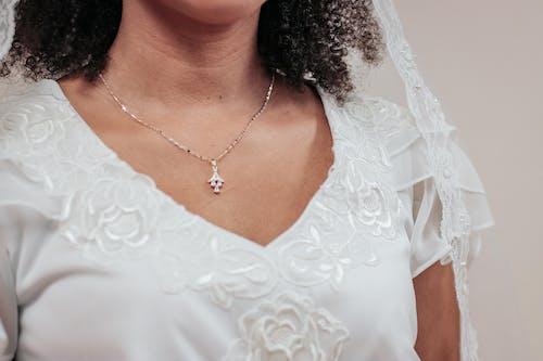Woman Wearing White Floral V-neck Dress