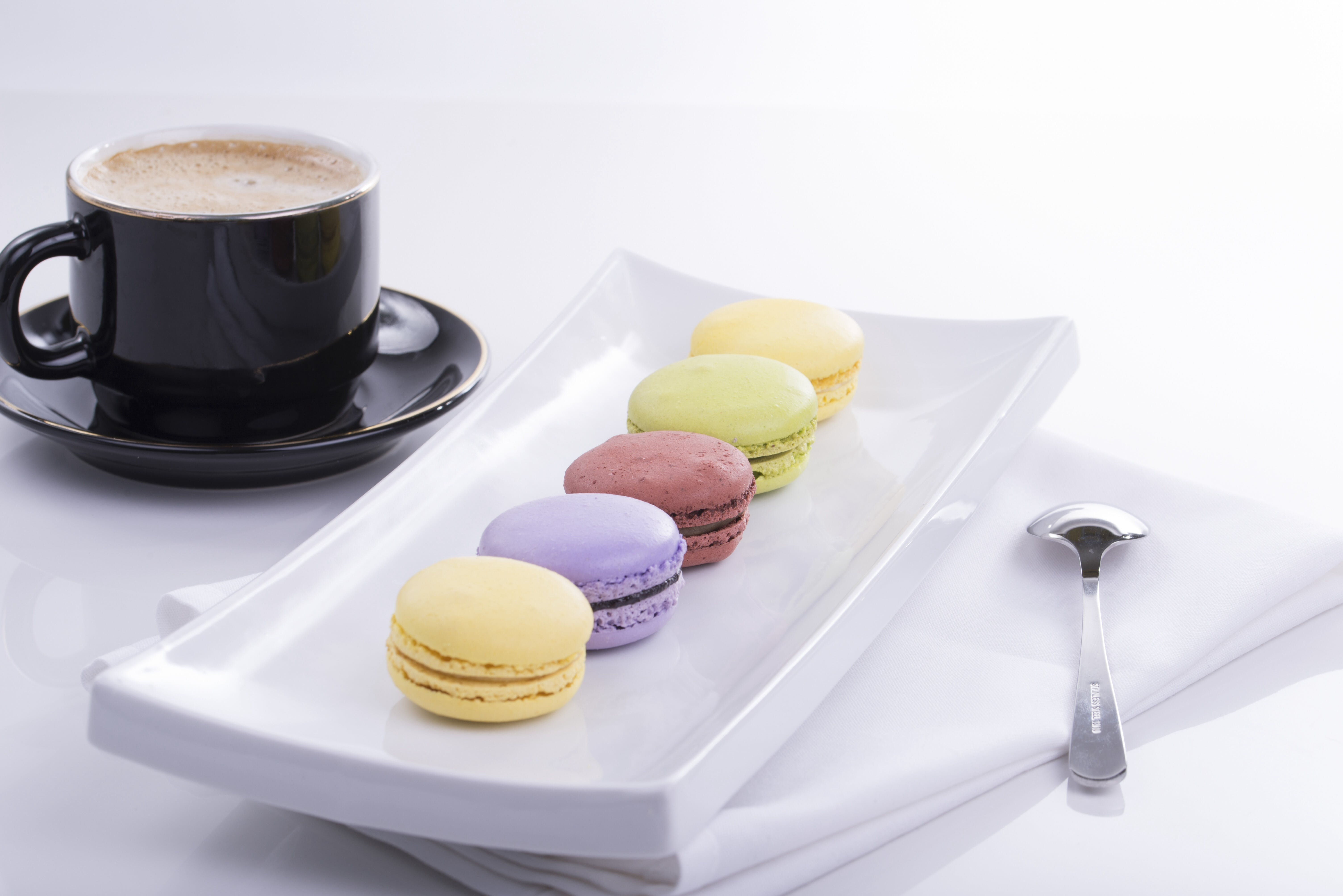 Black Teacup and 5 French Macaroons on Plate