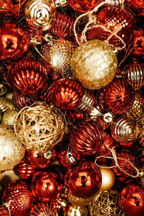 Shallow Focus Photo of Red and Gold Christmas Baubles
