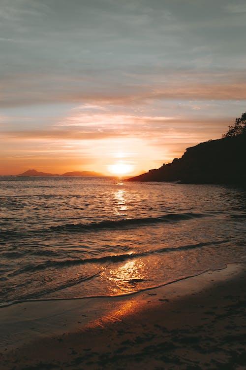 Photos gratuites de à contre-jour, aube, bord de mer, coucher de soleil