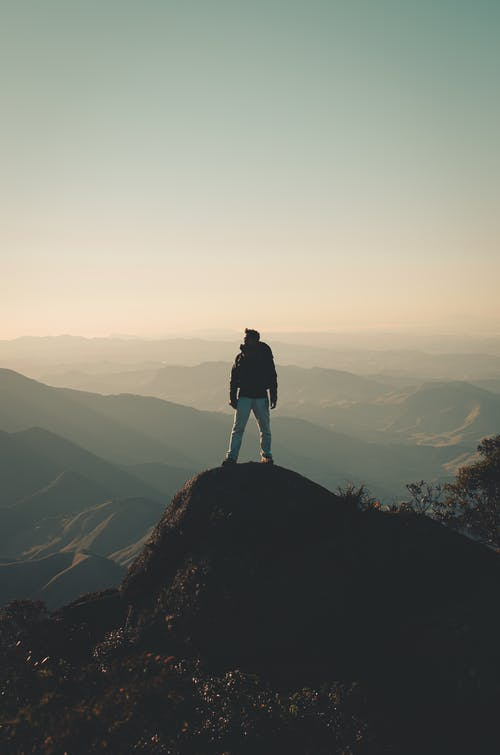 Photo Of Man Standing On Hill