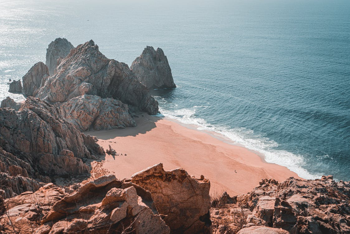 Photo Of Rock Formation Near Sea