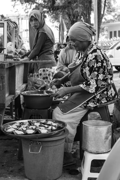Grayscale Photography of Women Cooking Food