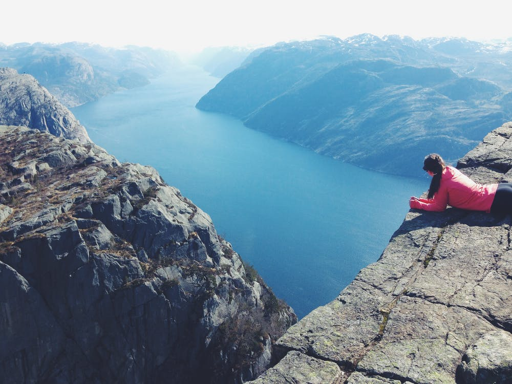 Woman Lying on Cliff
