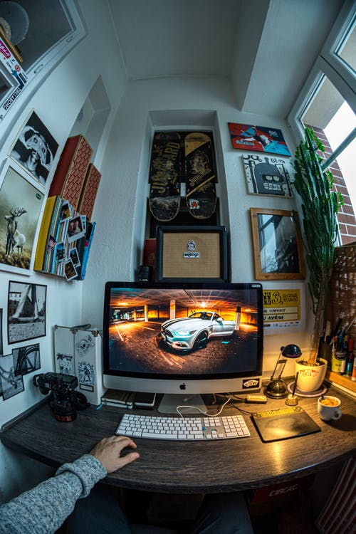Fisheye Photo of Turned-on Silver Imac