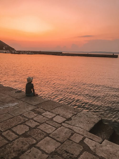 Free stock photo of beach sunset, Beautiful sunset, kid, kid staring at sunset