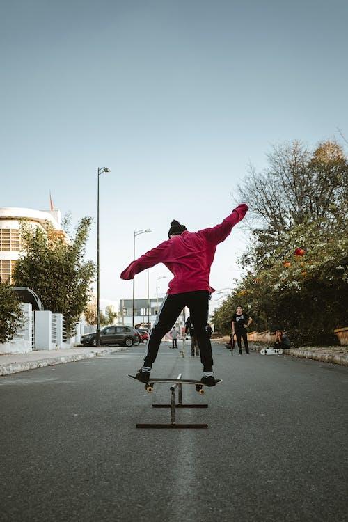 Person Performing Skateboard Stunt