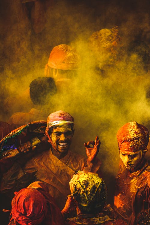 People Covered in Colored Powder