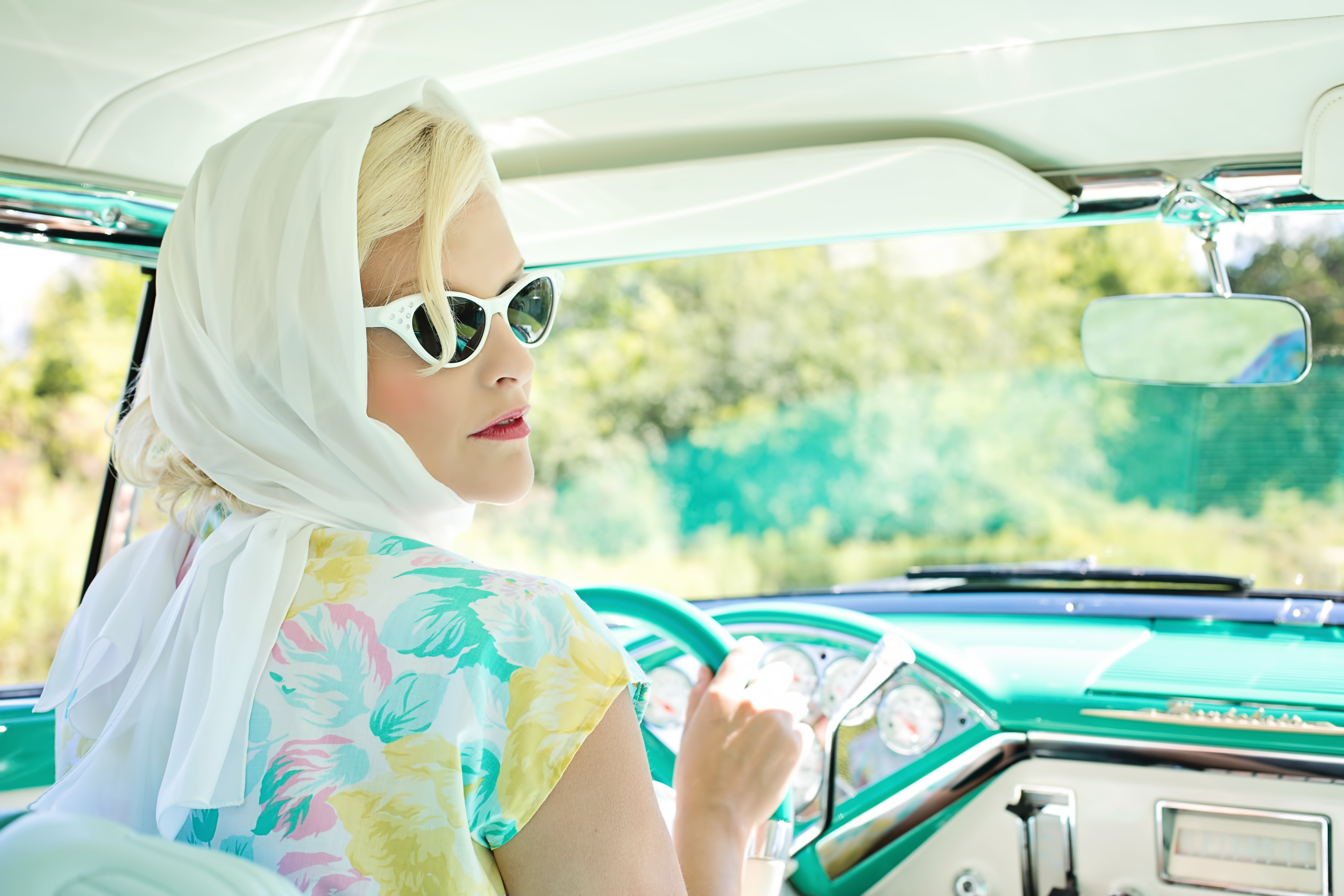 Woman Driving Vintage Car on Road during Daytime