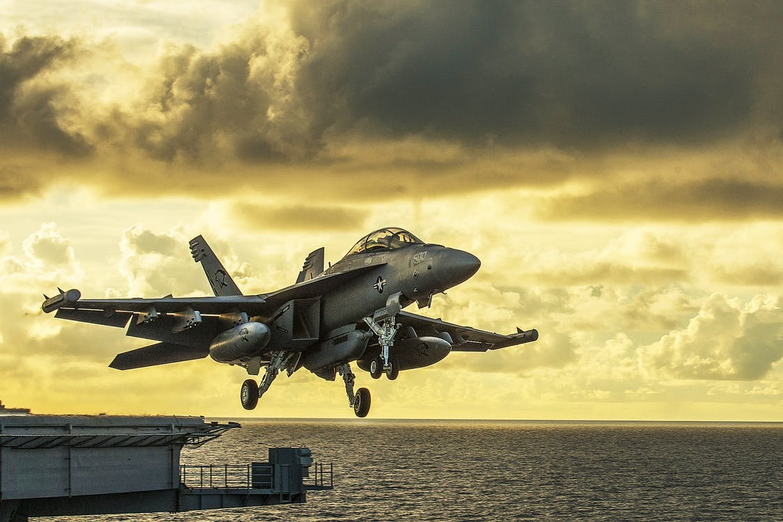 Gray Combat Air Craft Under Yellow Sky