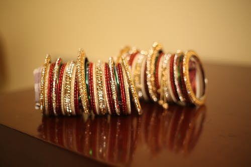 Free stock photo of bangles, red, still life