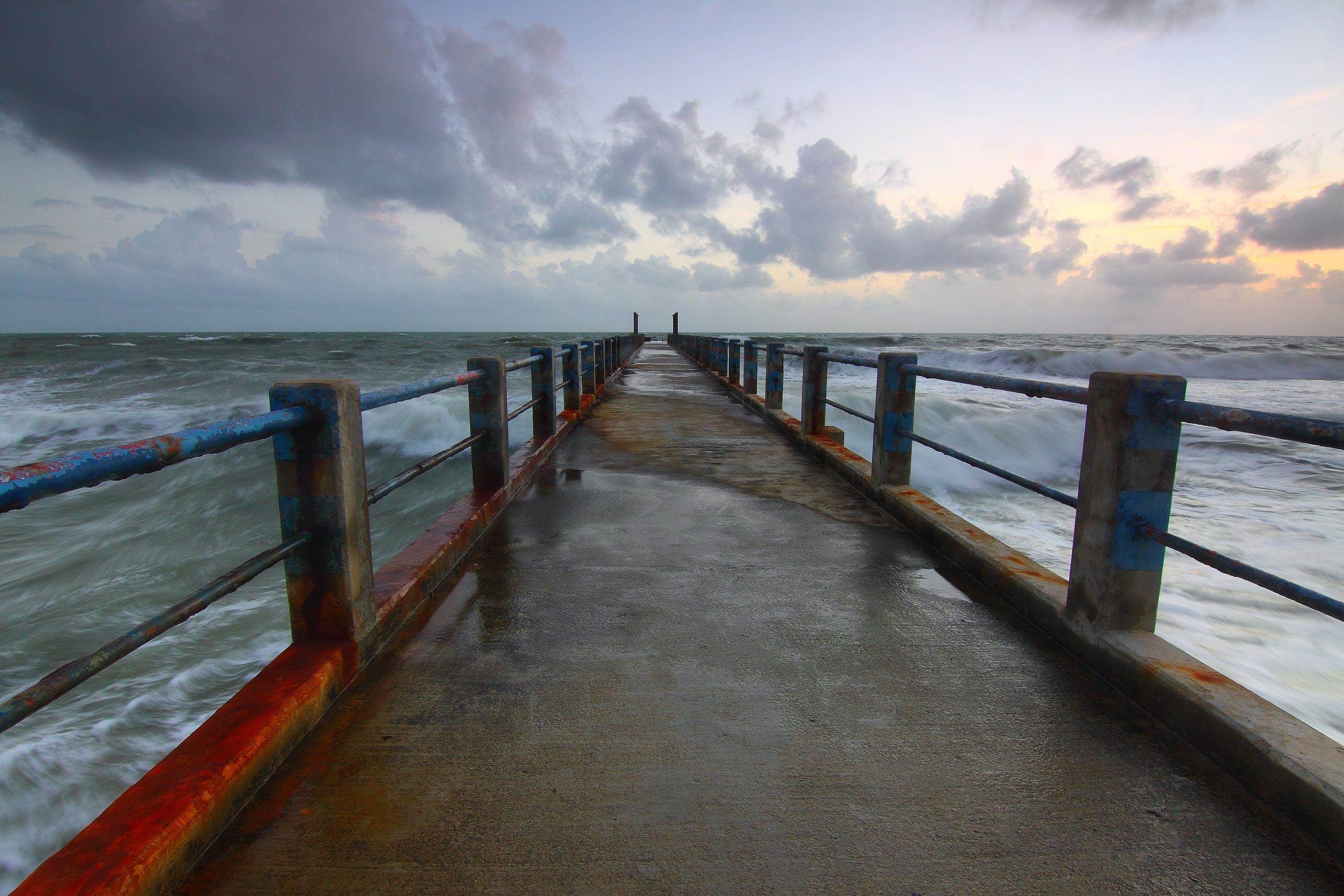 Foto profissional grátis de água, alvorecer, beira-mar, cais